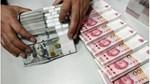 Tiền tệ ngày 14/3: Tỷ giá trung tâm và USD quốc tế đồng loạt giảm