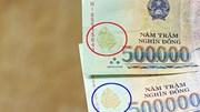 Ngân hàng Nhà nước khuyến cáo người tiêu dùng cảnh giác với tiền giả