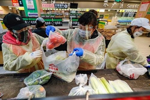 Cách Trung Quốc đảm bảo lương thực cho hàng chục triệu người dân trong những ngày phong tỏa - Ảnh 2.