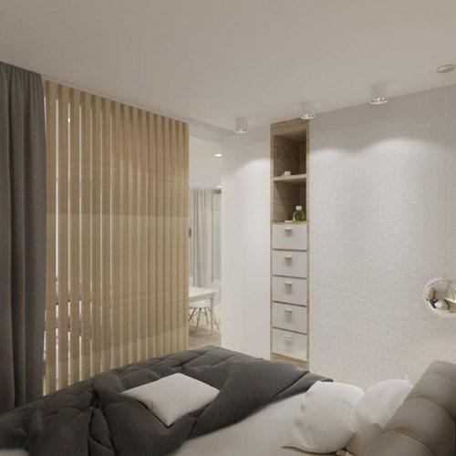 Góc nhỏ này được tách biệt khỏi không gia phòng khách bằng một hệ lam gỗ đẹp mắt.