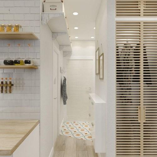 Không gian nơi lối vào còn được tận dụng làm nơi cất đồ lý tưởng với giá treo bằng gỗ và những chiếc vali nhỏ cao sát trần nhà.