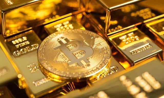 """Bitcoin """"đánh võng"""" chóng mặt, dòng tiền đổ ngược lại vàng?"""