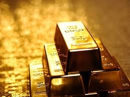 Giá vàng chạm đáy 2 tuần sau tuyên bố của Fed
