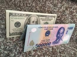 Tiền tệ ngày 9/3: Tỷ giá trung tâm tăng, USD quốc tế ngừng giảm